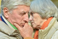 Pensive old couple Stock Photo