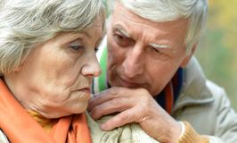 Pensive old couple Royalty Free Stock Photos