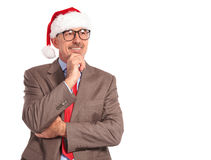 Pensive old santa claus businessman looks away Royalty Free Stock Image