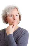 Pensive old woman Royalty Free Stock Image