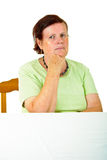 Pensive old woman Stock Image