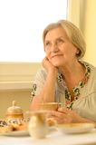 Pensive older woman resting Royalty Free Stock Photos