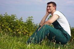 Pensive organic farmer stock images