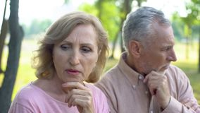 Pensive pensioners thinking of problem, crisis in relations, aged couple divorce