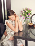 Pensive pregnant woman looking at her stomach. Stock Photography