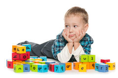 Pensive preschool boy with blocks Stock Photos
