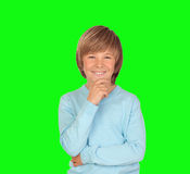 Pensive preteen boy. Isolated on a over green background Royalty Free Stock Photo
