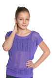 Pensive preteen girl against the white Stock Images