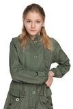 Pensive preteen girl in the coat Stock Photo