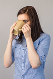 Pensive pretty brunette drinking coffee Stock Photos
