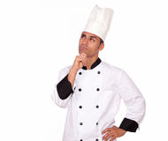 Pensive professional chef looking to right up Stock Photos