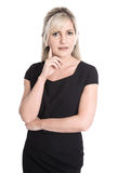 Pensive and questioningly isolated businesswoman in portrait. Stock Photos