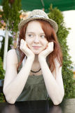 Pensive red hair woman wearing straw hat Royalty Free Stock Photos