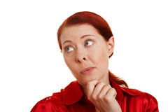 Pensive redhaired woman. With hand on her chin Royalty Free Stock Photo