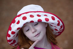 Pensive redhead in hat Stock Photo