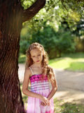 Pensive sad blonde girl in the park Stock Photos