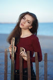Pensive sad lonely Caucasian young beautiful woman with messy long hair on windy day Royalty Free Stock Photo
