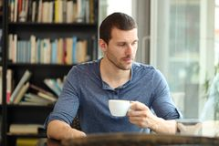 Free Pensive Sad Man Looks Away In A Coffee Shop Royalty Free Stock Photography - 159807277