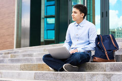 Pensive Schoolboy with Laptop Outdoors royalty free stock images