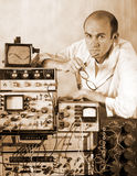 Pensive scientist at vintage laboratory Stock Image