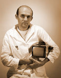 Pensive scientist with vintage monitor Stock Images