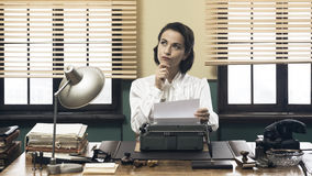 Pensive secretary with typewriter Stock Photo