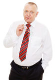 Pensive senior businessman with glasses near face Royalty Free Stock Photography