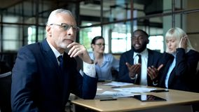 Free Pensive Senior Businessman Thinking, Nervous Colleagues Arguing, Stress At Work Royalty Free Stock Photos - 159288218