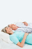 Pensive senior couple in bed Royalty Free Stock Photo