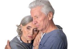Pensive senior couple Stock Photos