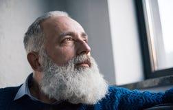 Pensive senior man. Close-up view of pensive bearded senior man looking at distance Royalty Free Stock Photos