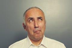 Pensive senior man looking up Royalty Free Stock Photo