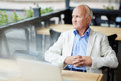 Pensive Senior Man at Outdoor Cafe Royalty Free Stock Images