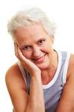 Pensive senior woman Stock Image