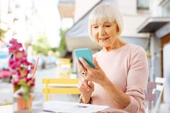 Pensive senior woman checking calls royalty free stock photos