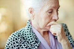 Pensive senior woman Royalty Free Stock Photos