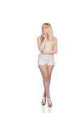 Pensive sensual girl with shorts Royalty Free Stock Photography
