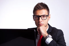 Pensive serious business man at desk Royalty Free Stock Photography