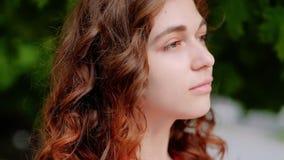 Pensive serious woman closeup portrait city trees stock footage