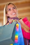 Pensive shopping woman Royalty Free Stock Images