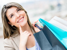 Pensive shopping woman Stock Photography