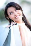 Pensive shopping woman Royalty Free Stock Photo