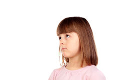 Pensive small girl with pink t-shirt Stock Photos