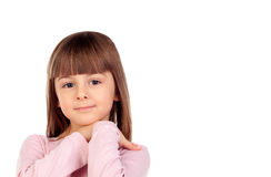 Pensive small girl with pink t-shirt Stock Image