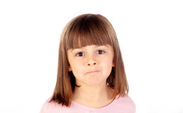 Pensive small girl with pink t-shirt Stock Photo