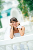 Pensive smiles bride has leant the elbows on ha Royalty Free Stock Image