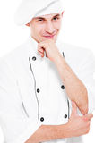 Pensive smiley cook. Portrait of pensive smiley cook over white background Royalty Free Stock Photo