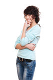 Pensive smiley woman over white background Stock Images