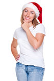 Pensive smiley woman in santa hat Royalty Free Stock Image
