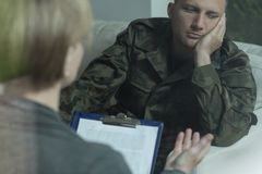 Pensive soldier during psychotherapy session Royalty Free Stock Photo